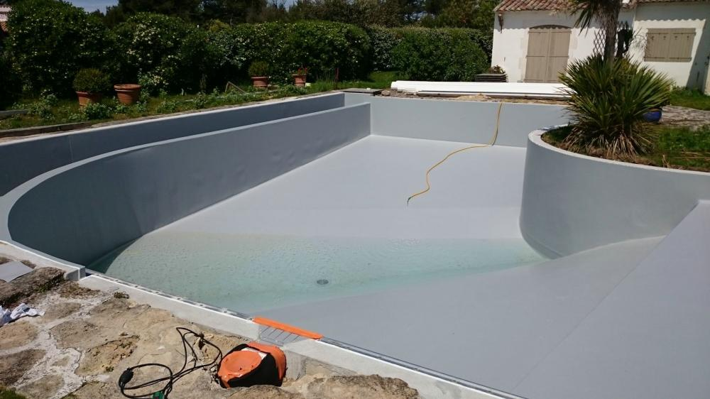 Pose de liner arm piscine en r novation les portes en for Pose de liner pour piscine